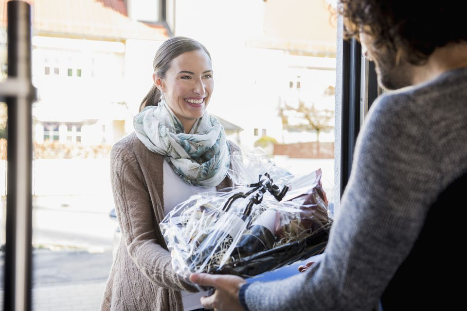 Woman delivering food to friend