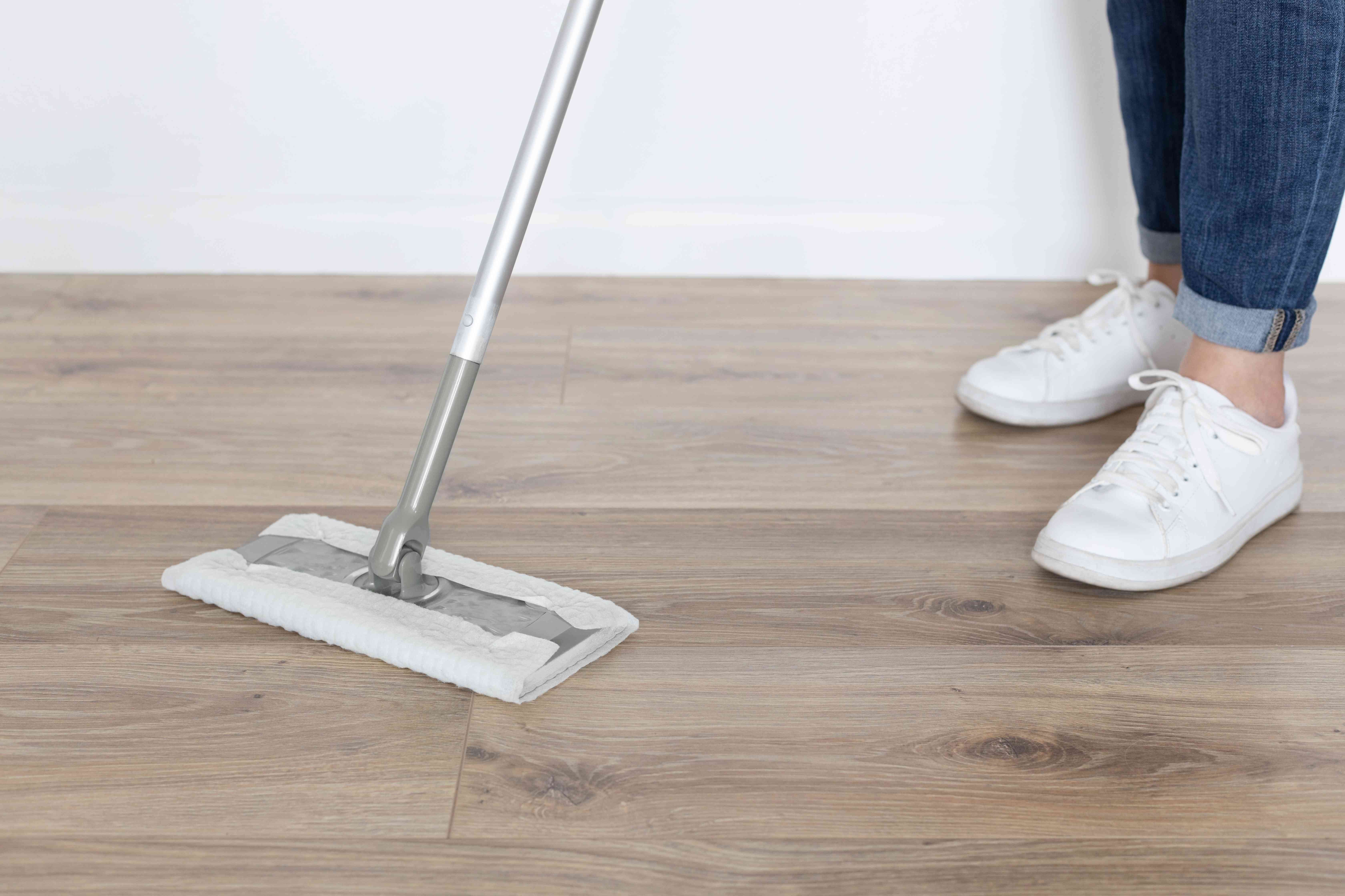 Wooden flooring being swept to prevent ants