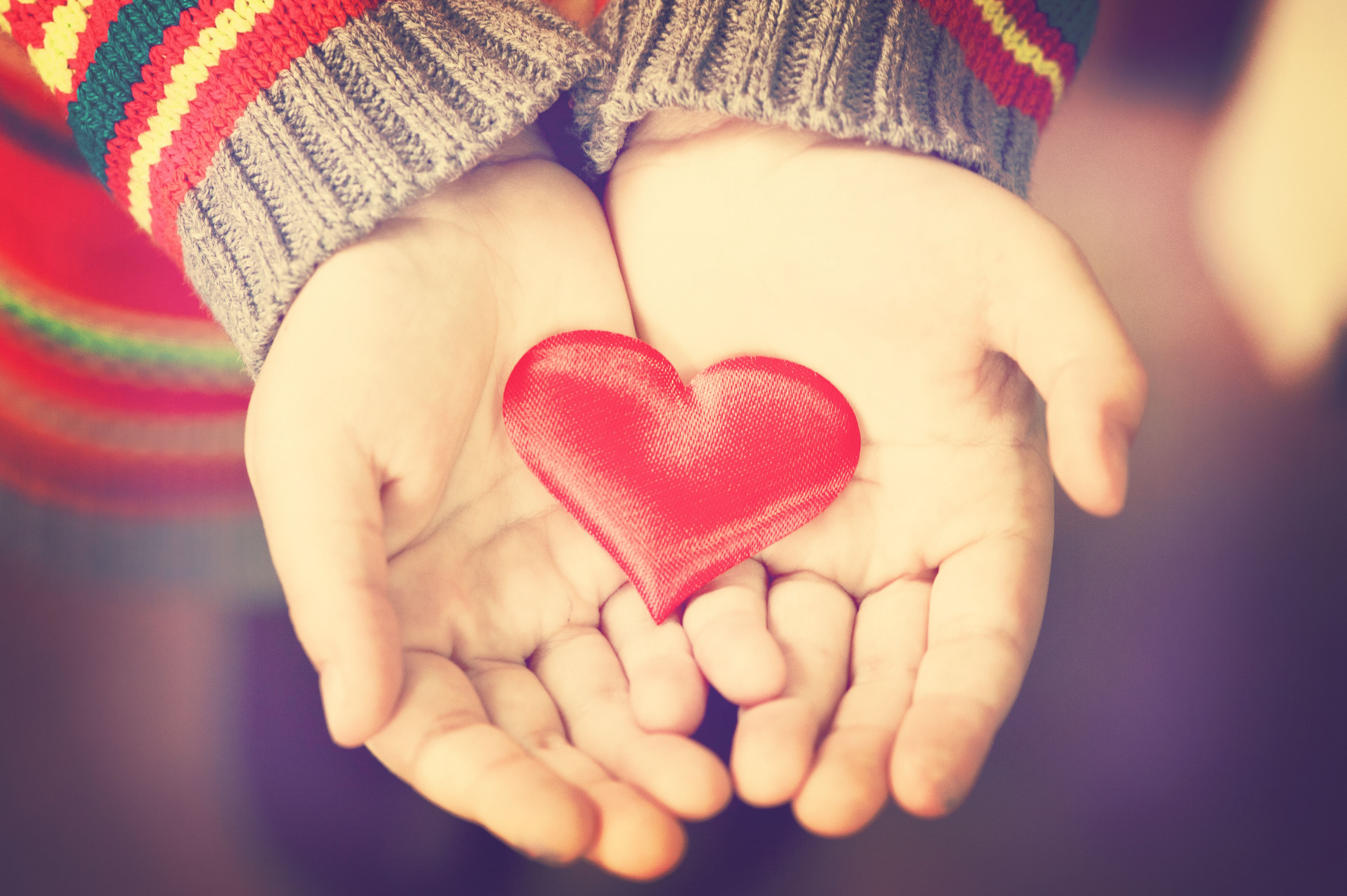Siky read heart in child's hands