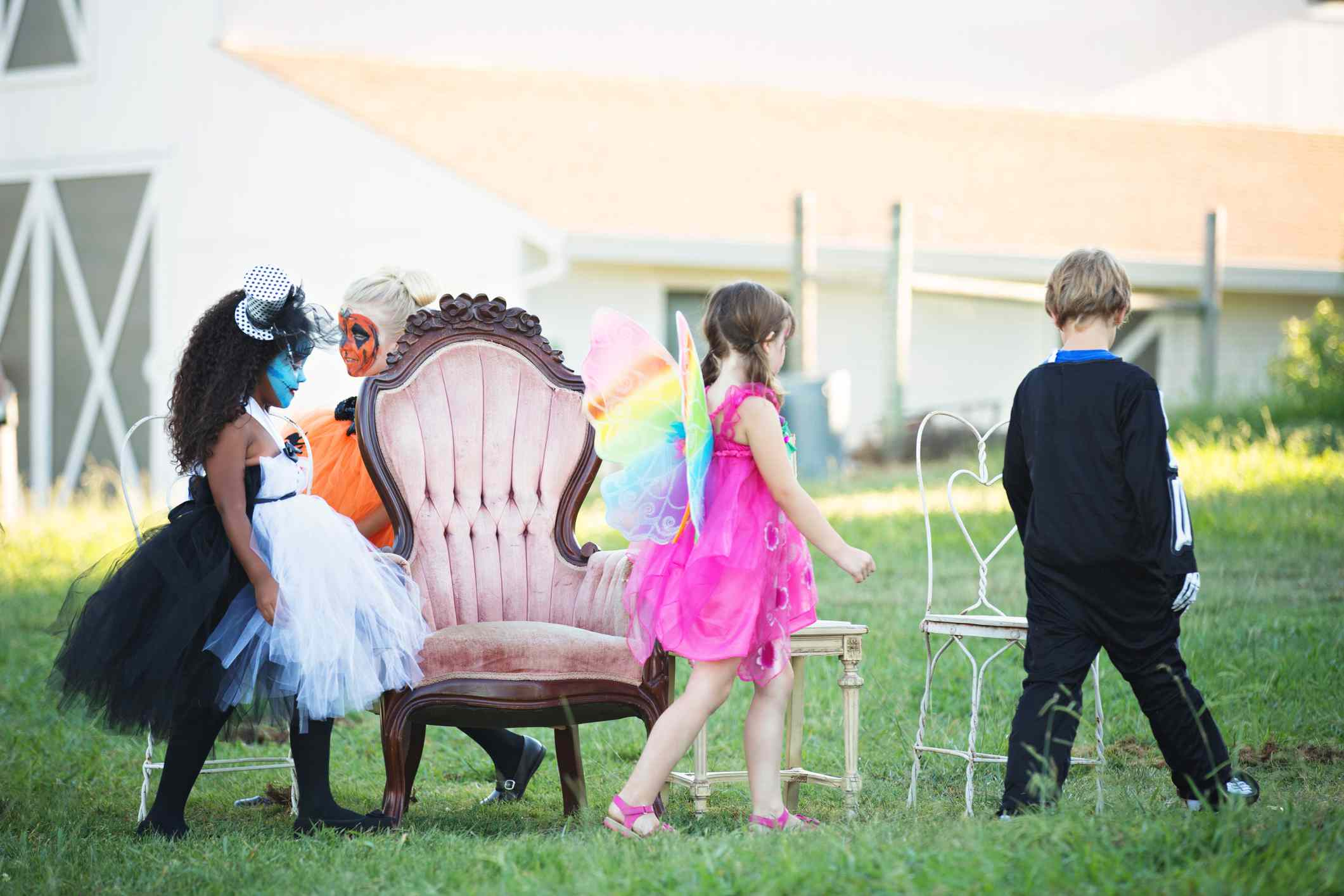 Kids playing Halloween musical chairs