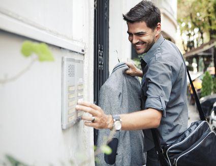 Man Uses Apartment Building Intercom