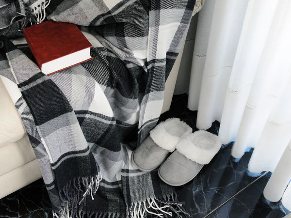 Checkered plaid black and white blanket with slippers