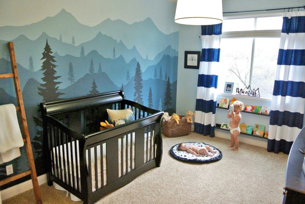 Woodland-themed nursery with Ombre mountain mural