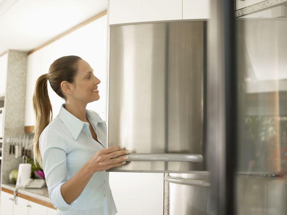 woman using freezer