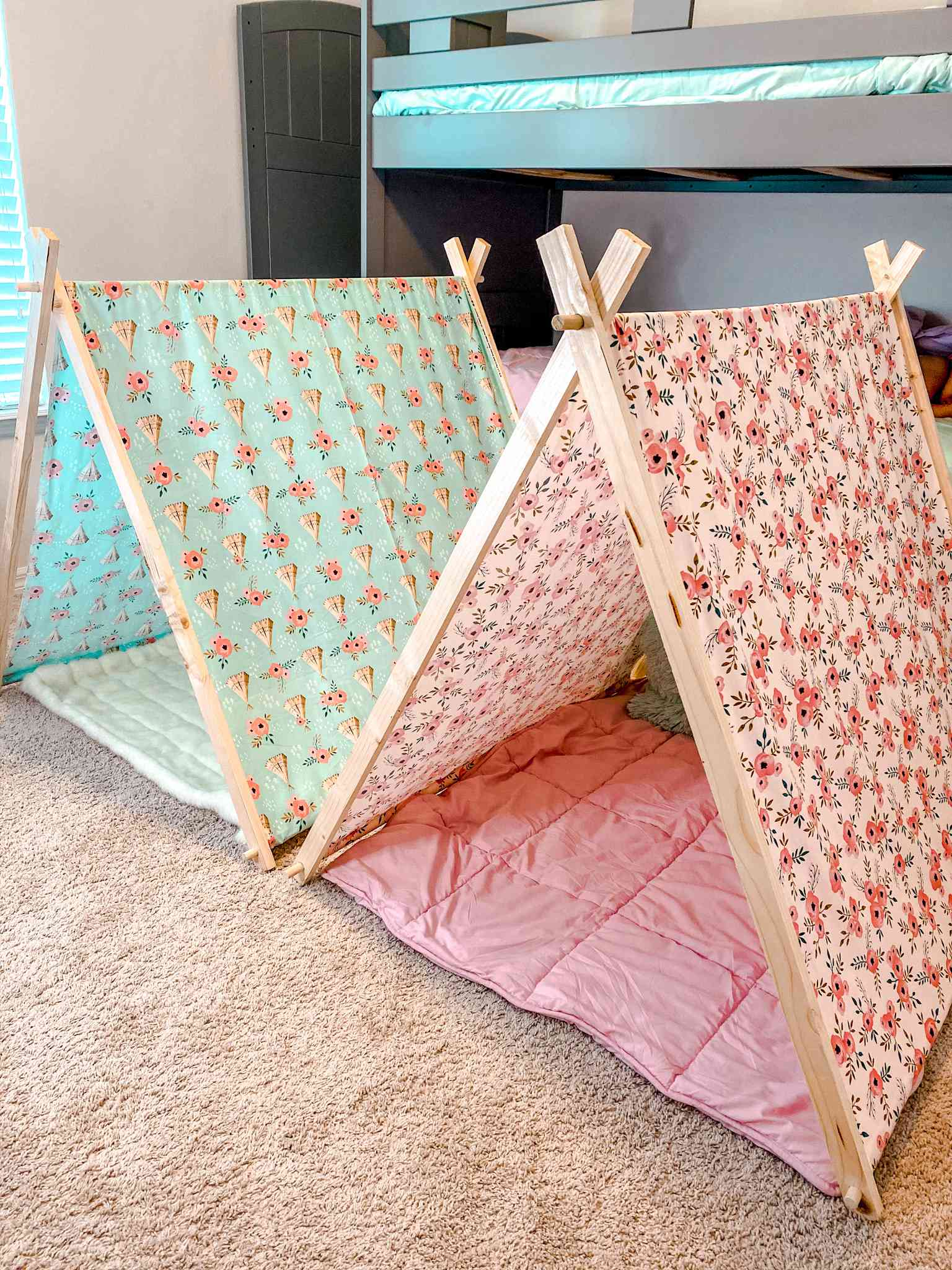 A blue and pink play tent in a bedroom