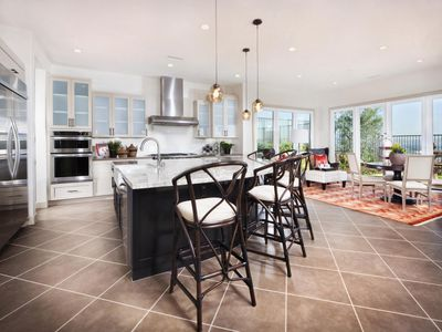 Stools arranged at breakfast bar in contemporary kitchen