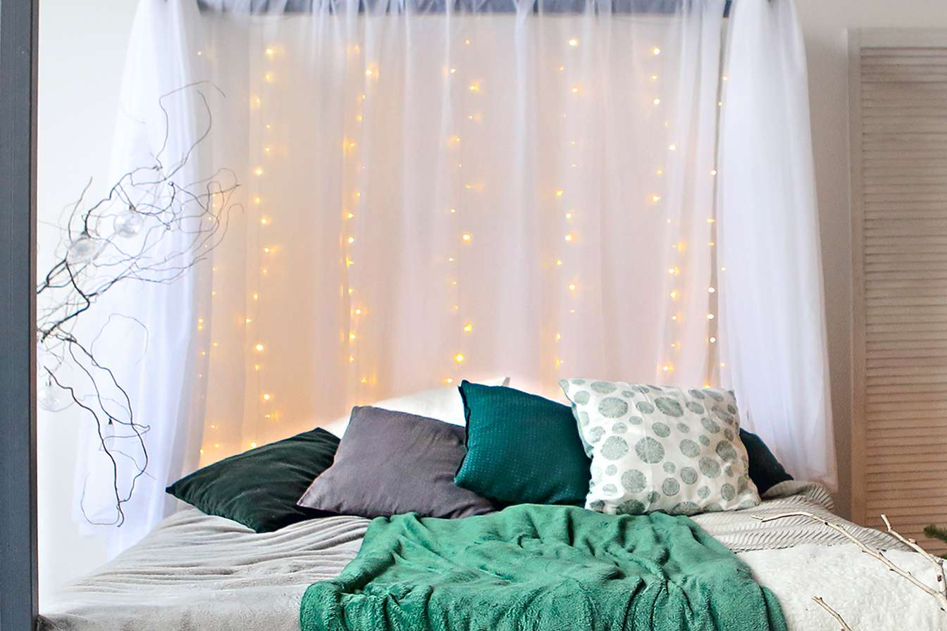 twinkle light curtains in a bedroom