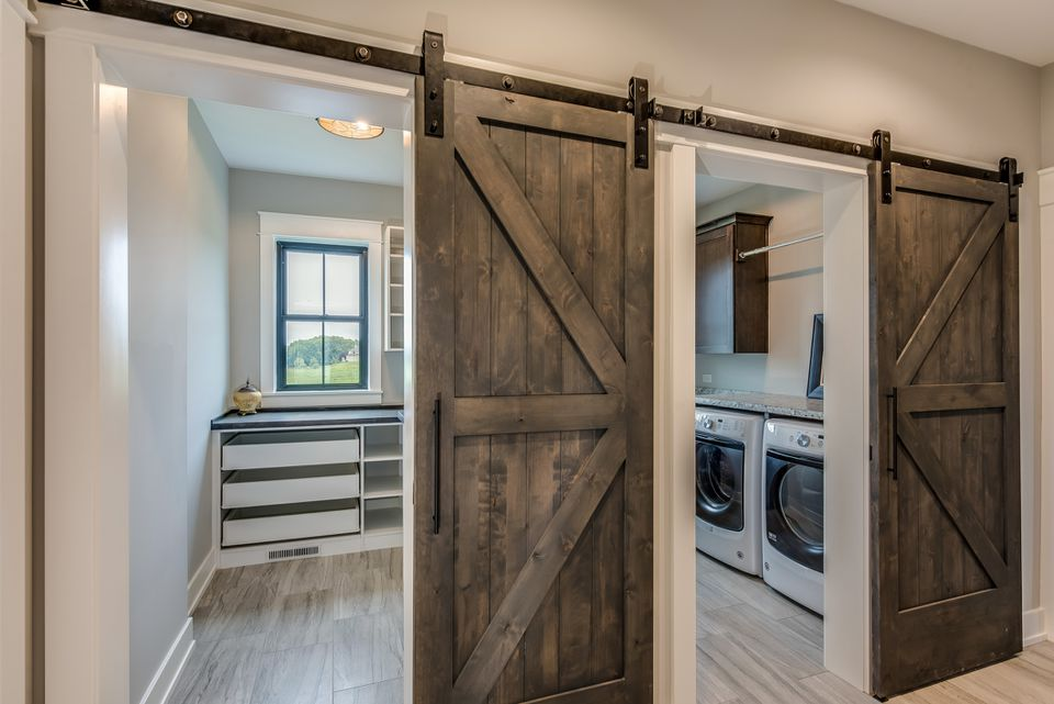 Huge laundry room with barn doors entrance