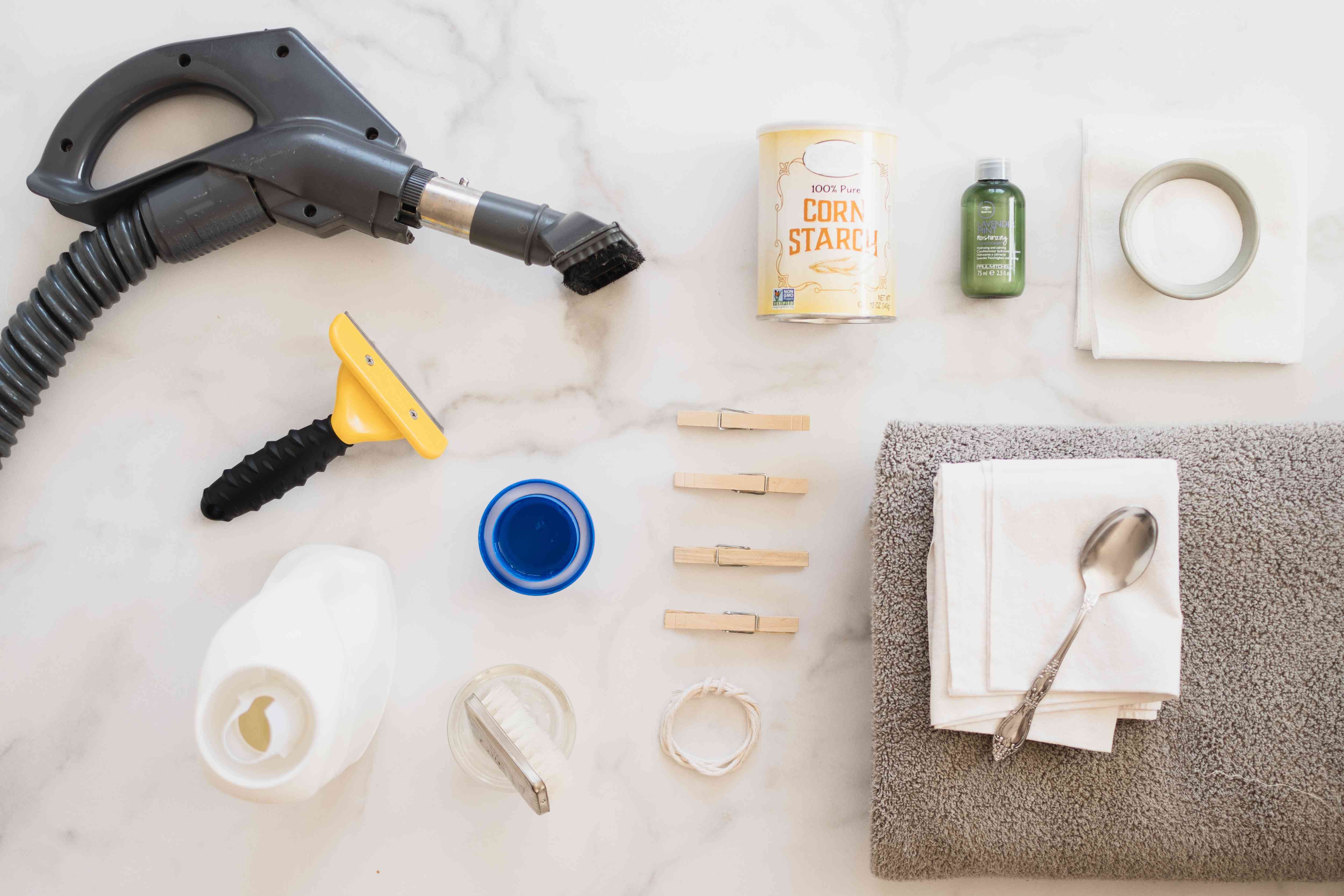 Materials and tools to clean sheepskin rug