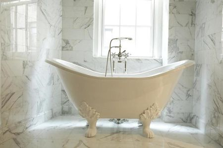 Deep Soak Clawfoot Tub In Marble Bathroom