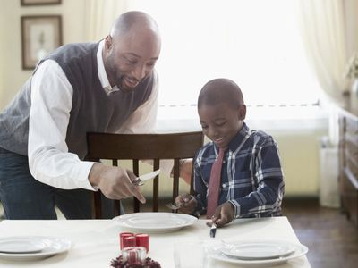 Father and son setting table
