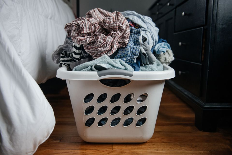 an overflowing laundry basket