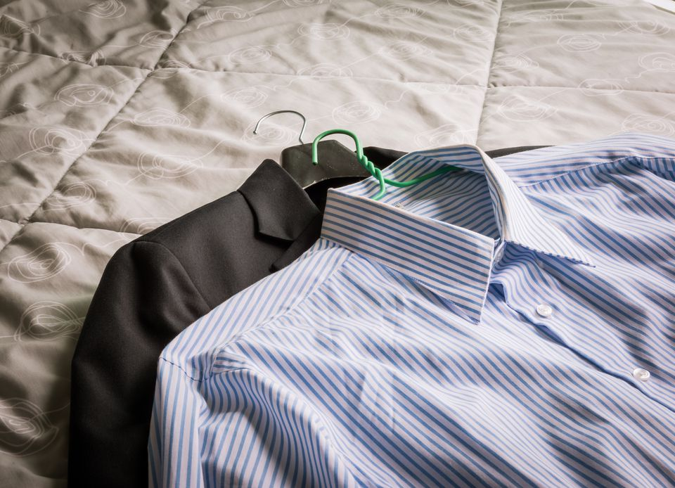 Men's classic shirts and suit on the bed