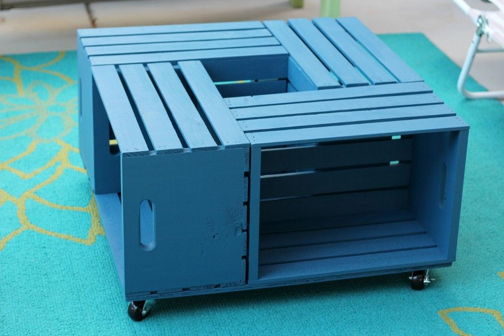A blue coffee table made out of crates