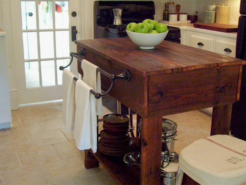 A Wooden Kitchen Island With Large Shelf On The Bottom
