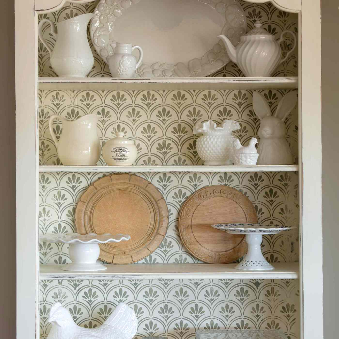 Painted and stenciled bookcase sanded for an antique look.