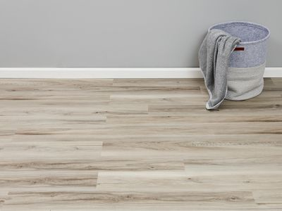 Vinyl basement flooring with basket and fabric