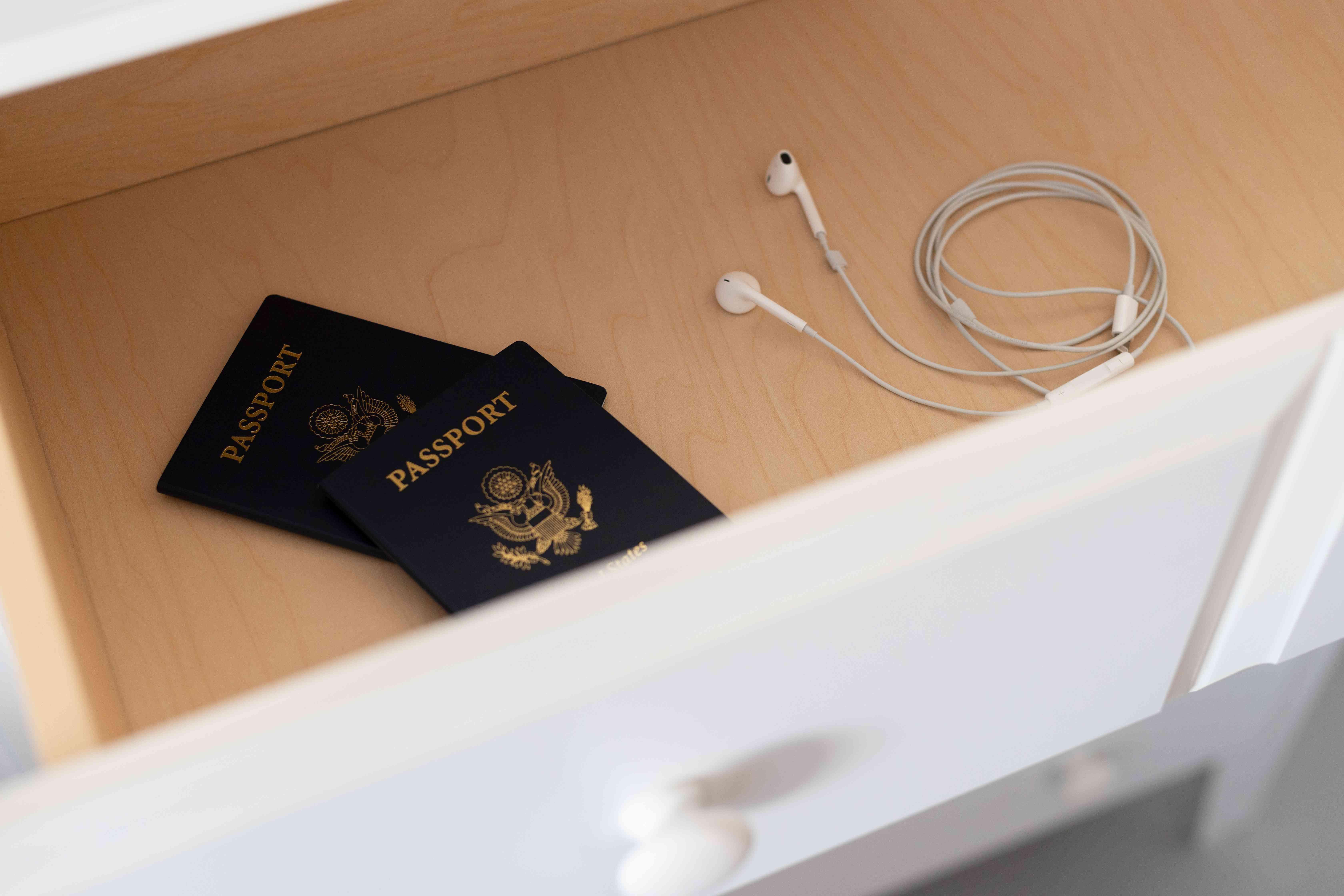 Passport documents and headphones in empty drawer