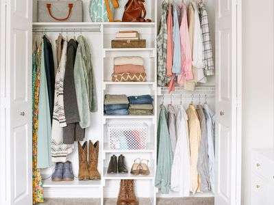 Small closet organized with hanging shirts, shoes and handbags