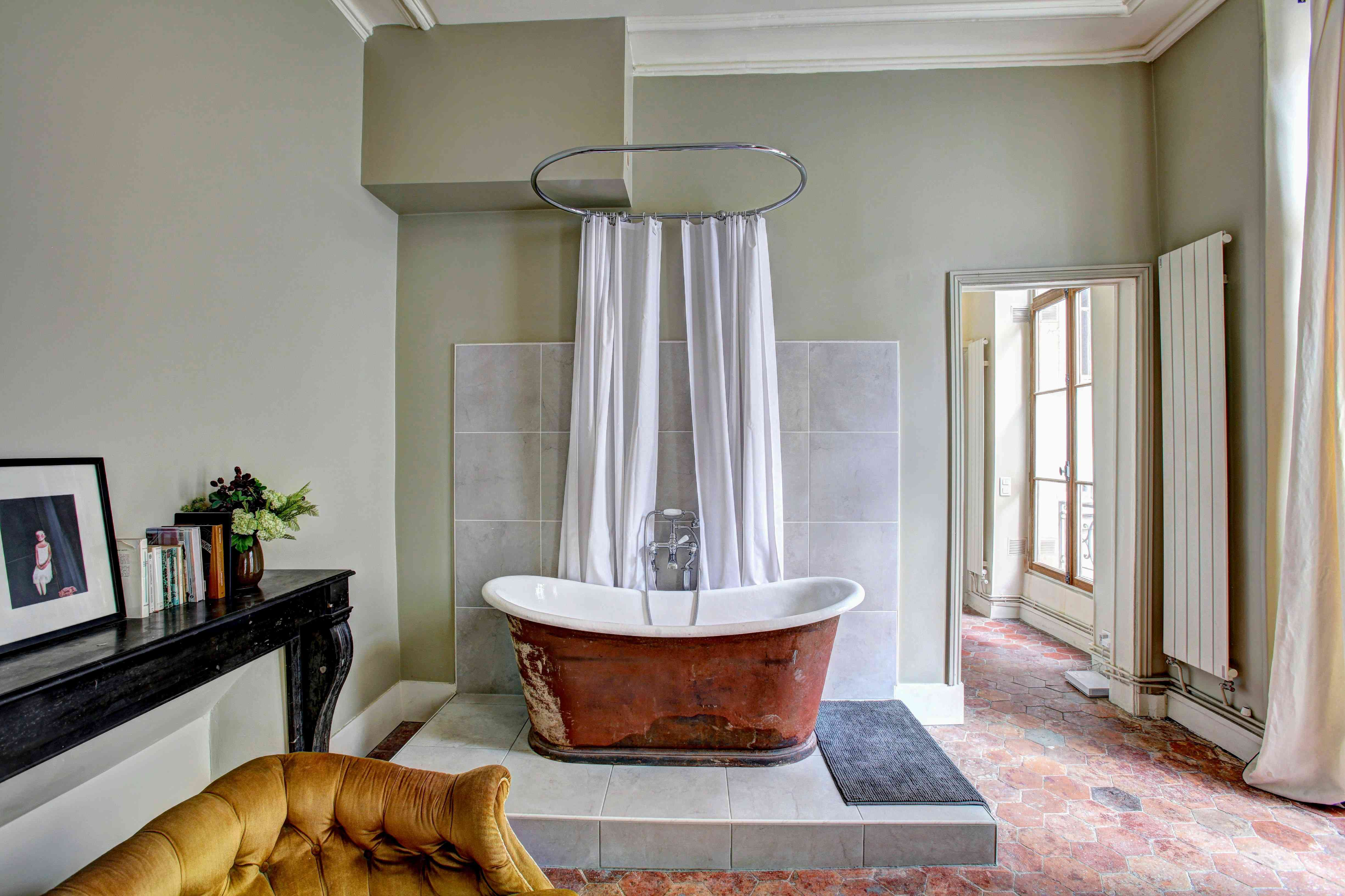 Copper bathtub in French country style room