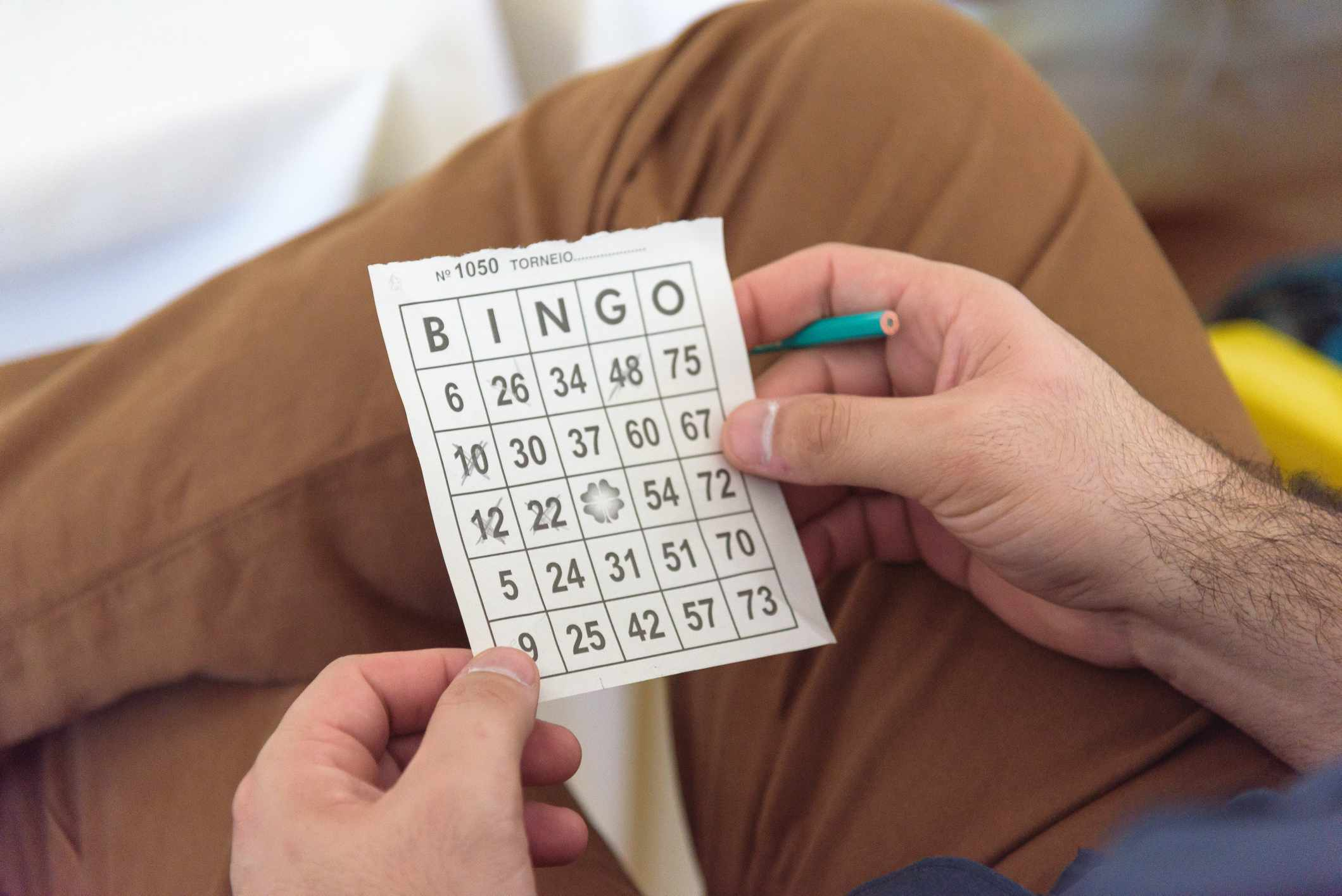 Midsection Of Man Holding Bingo Game