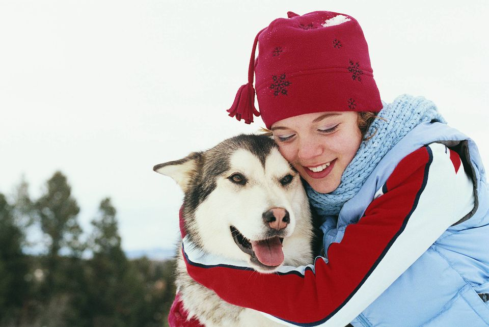 A picture of a girl hugging her dog