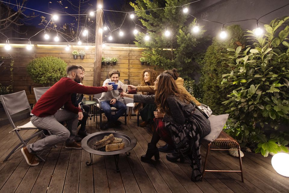 friends gather near fire pit