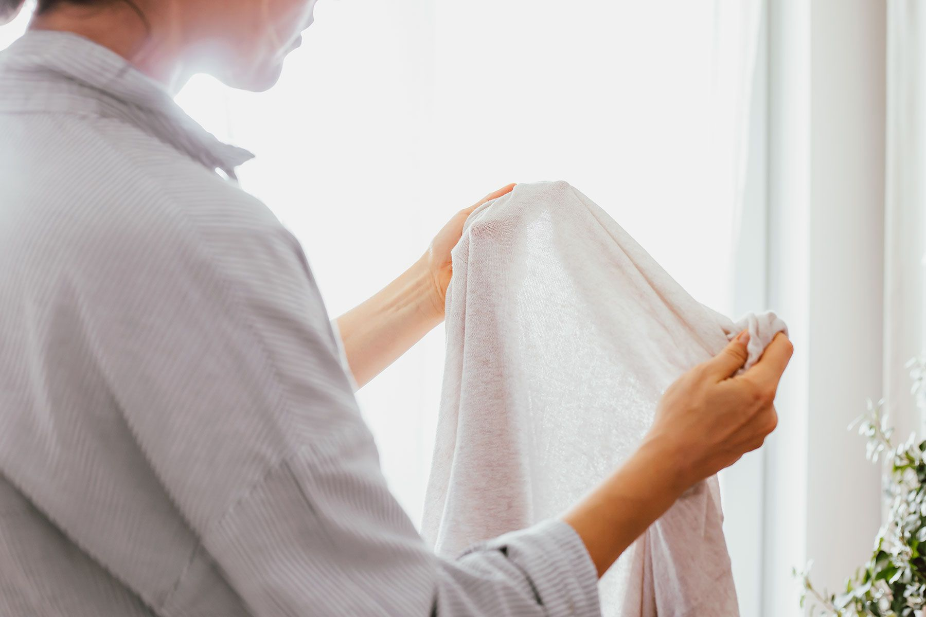 A woman inspecting laundry