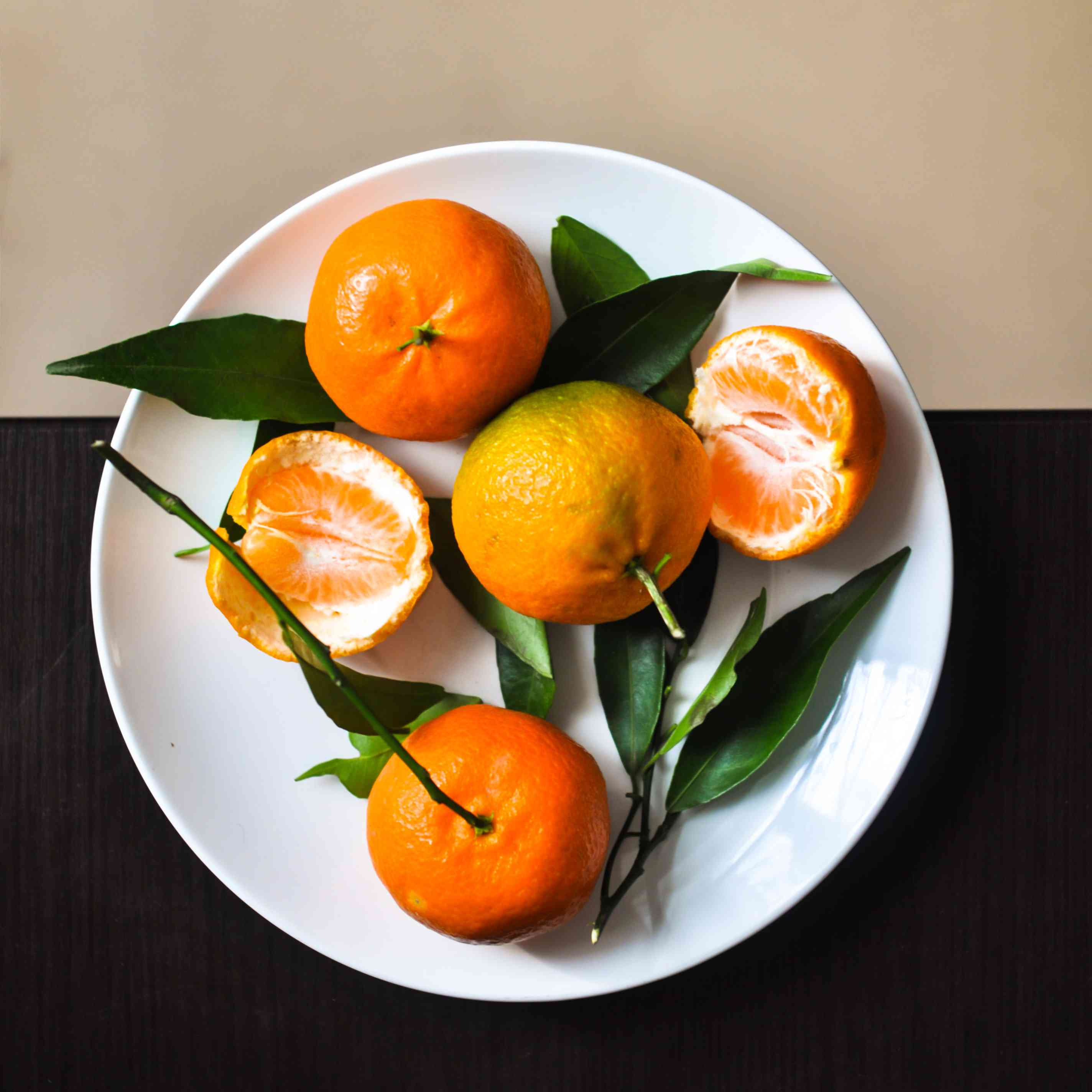 tangerines on a white plate
