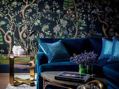 moody room with floral wallpaper