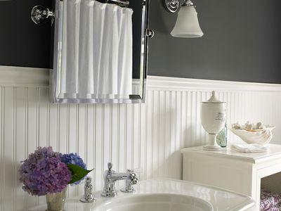 beadboard bathroom with black walls