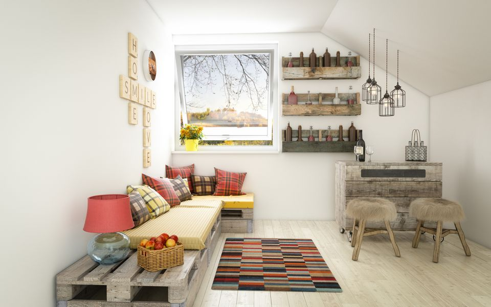 Living space with rug, couches, seating areas, pendant lights, and window.