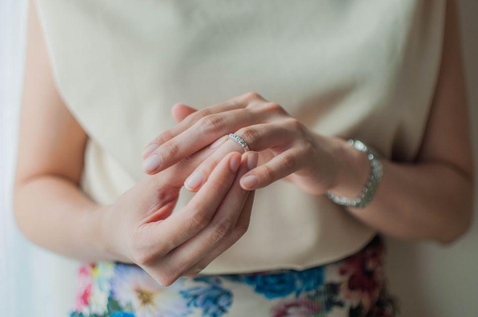 Young woman wearing wedding ring