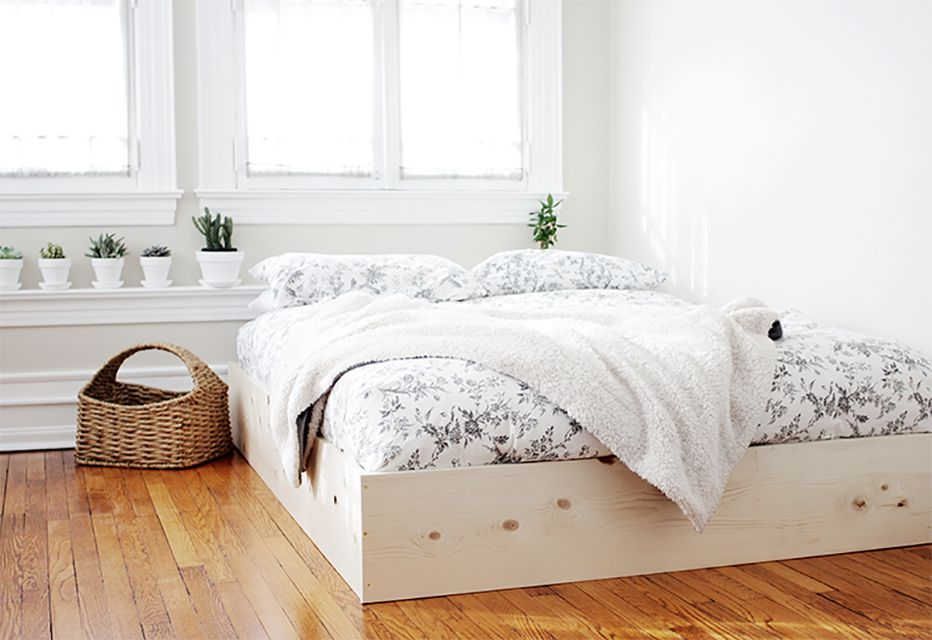 A wooden bed on the floor