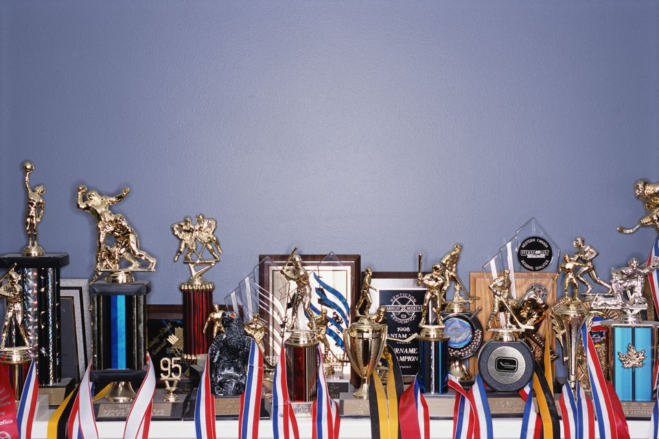 Trophies and sports memorabilia on shelf