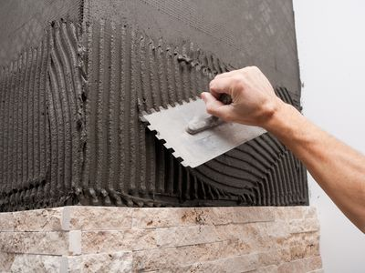 Tiling with a square notch tile trowel
