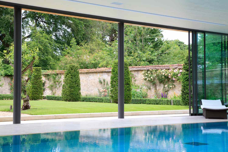 indoor pool with garden view