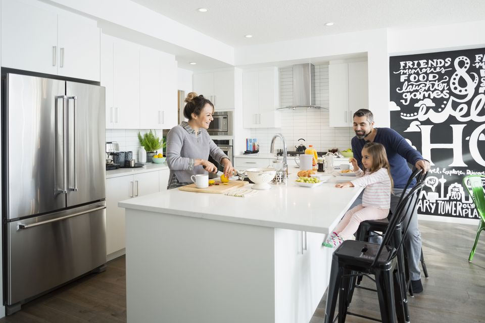 Family enjoying breakfast in morning kitchen