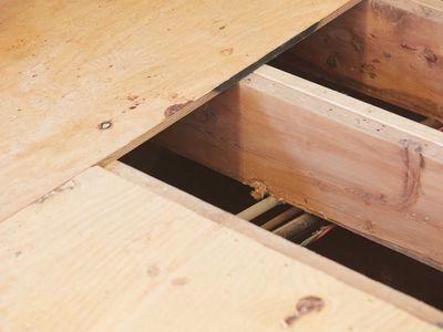 Subfloor with wooden joists closeup