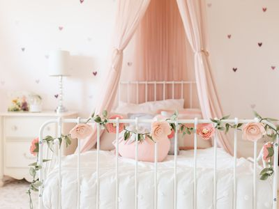 Toddler Girl room with felt flowers and canopy