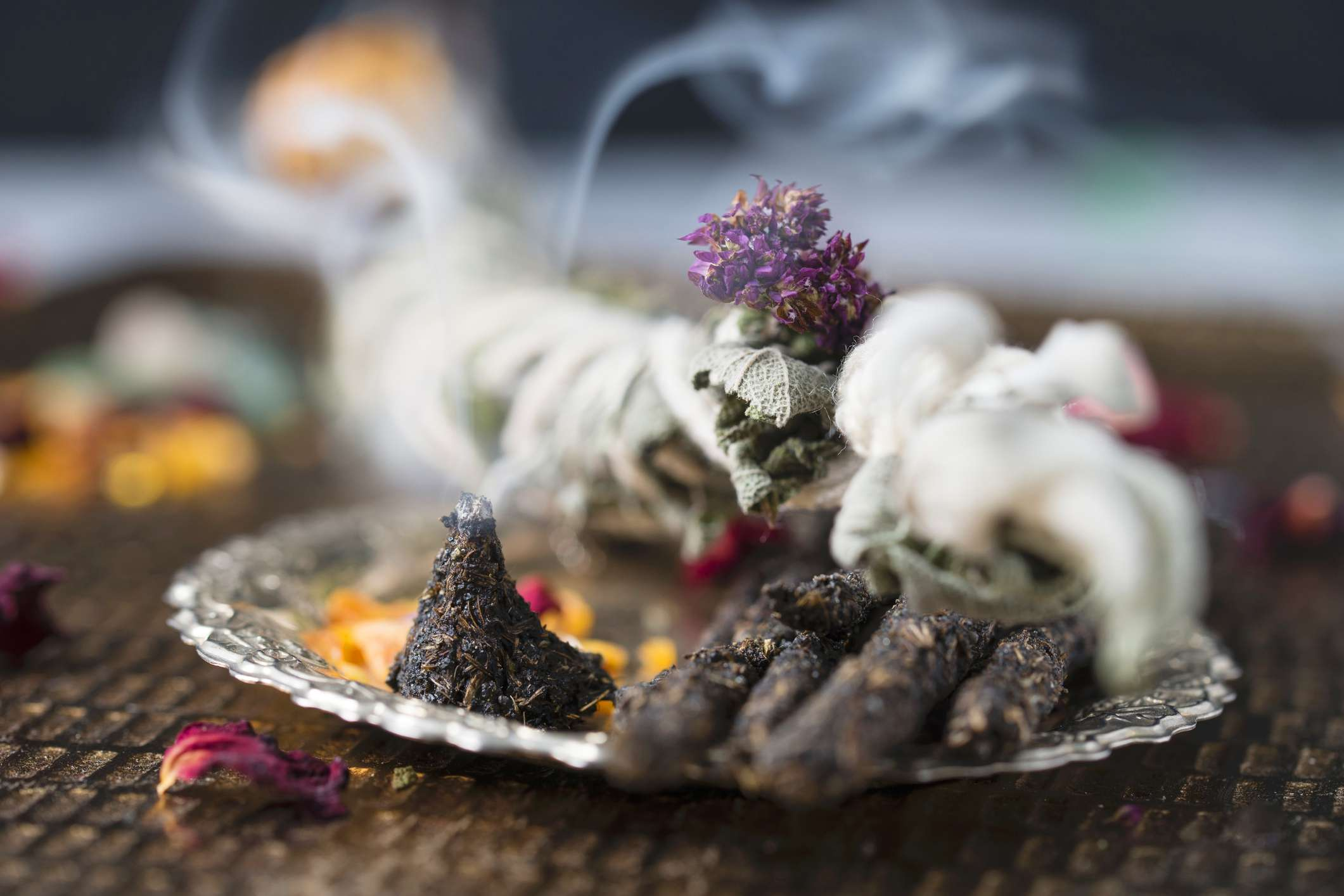 Smudging with herbs and sage for space clearing