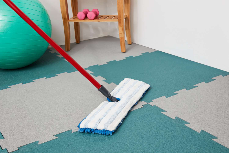 Mopping rubber floor tiles