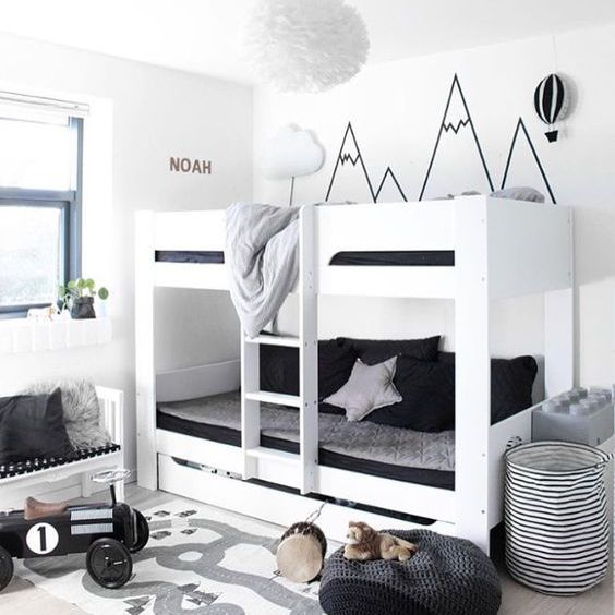 Modern black and white bedroom with washi tape mountain mural