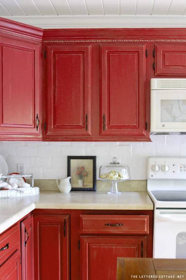 red cabinets and white ceiling