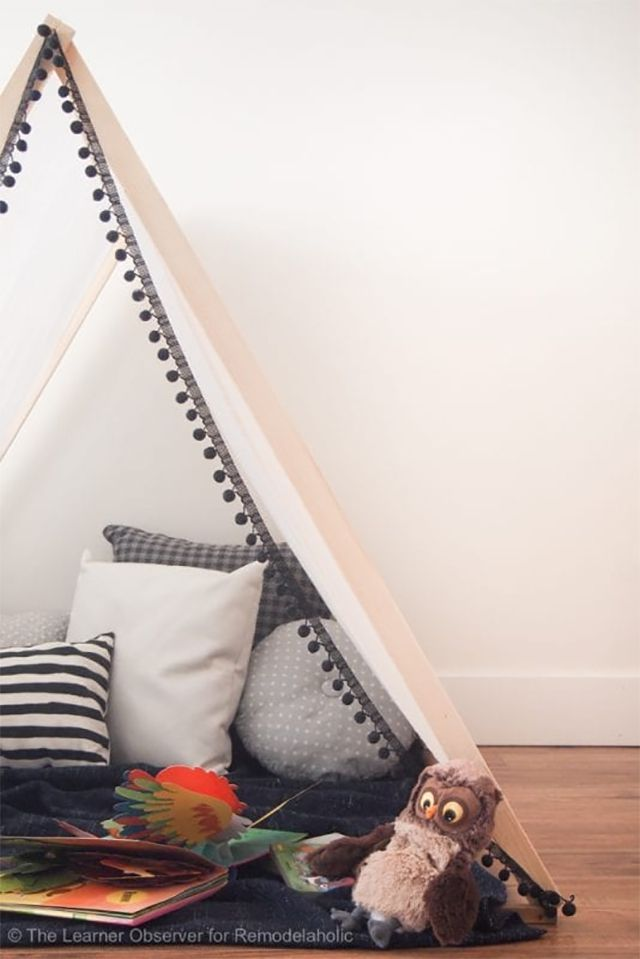 A play tent with pillows and stuffed animals