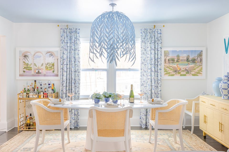 tropical colorful dining room with cane chairs