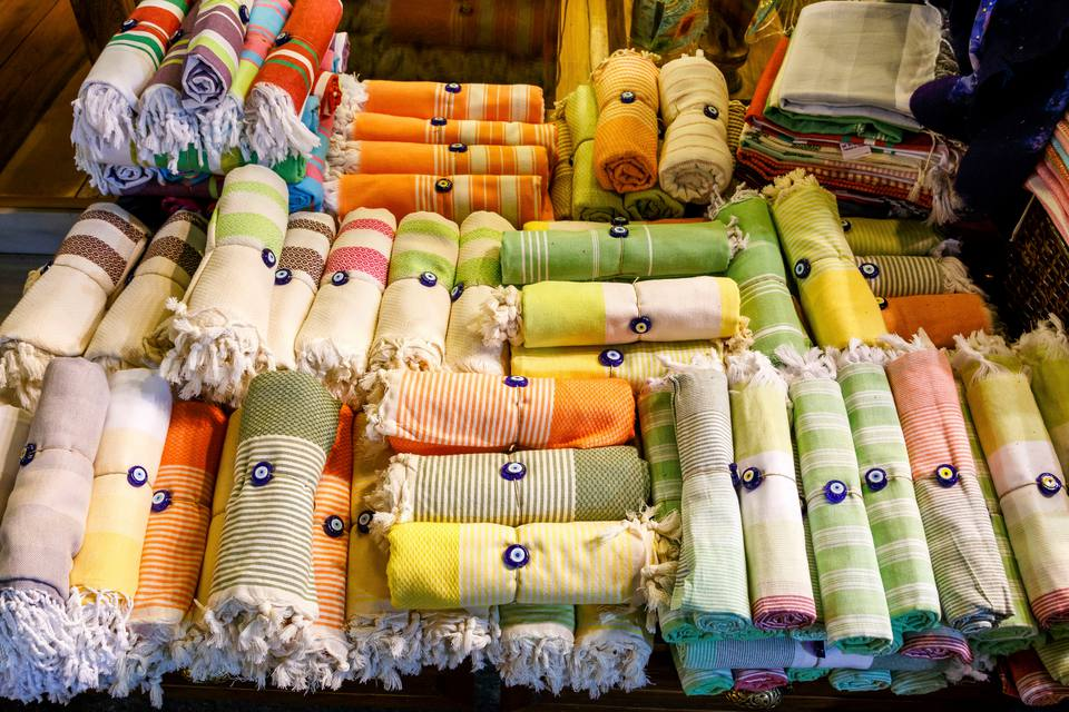 High Angle View Of Rolled Up Towels Tied With Evil Eye Beads At Market For Sale