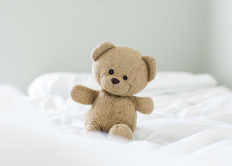 a teddy bear on a bed