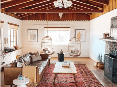 A Southwestern-style living room with wooden ceiling beams.