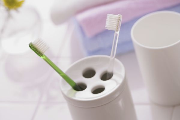 Toothbrushes and Holder - stock photo
